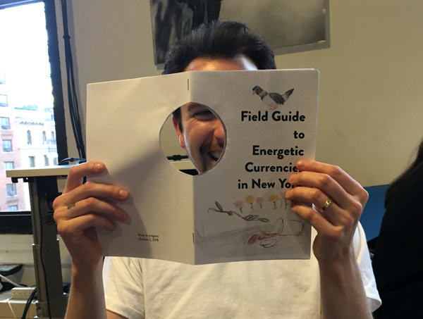 marco reading the field guide